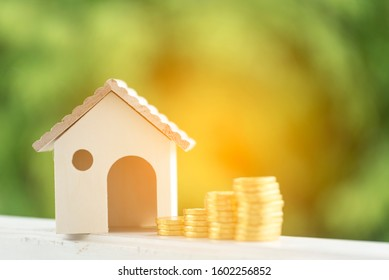 Investment buy house property home loan mortgage advice real estate marketing interest asset with golden money coin stack.Saving Money Concept. Woman hand holding budget buy house real estate agent.
