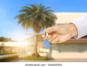 Investment concept ,House key in hand