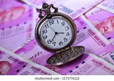 investment concept, pocket watch on money, indian rupees, savings, finance, and banking concept.