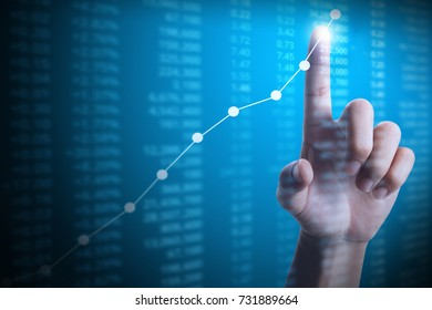 Investment concept,businessman with financial chart symbols coming from hand