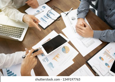 Investment and cooperate concept, business financial inspector analyzing about parformance data in office meeting.