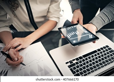 Investment department working process.Photo finance manager showing reports modern tablet screen.Statistics graphics screen.Private banker holding pen for signs documents, business project.Horizontal