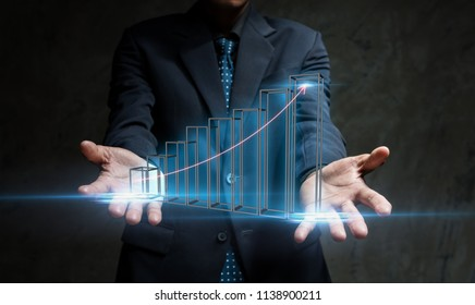 Investment and growth concept,Business man presenting Financial data graph growth up of organization