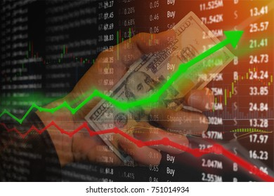Investment money gain on investment and hand with hundred dollar bill with rise and fall arrows.