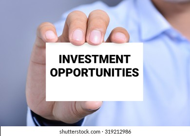 INVESTMENT OPPORTUNITIES message on the card shown by a man