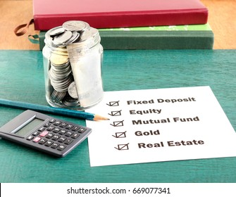Investment options, including fixed deposit, equity, mutual fund, gold and real estate, concept.