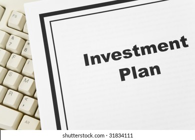 Investment Plan and computer keyboard, business concept