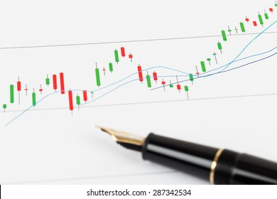 Investment report with pen