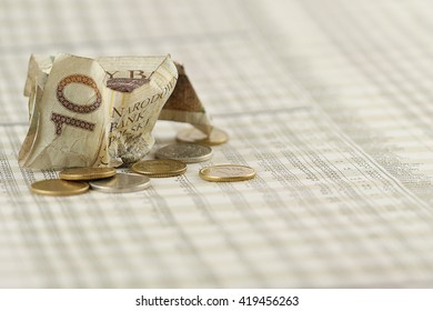 Investment risk concept. Crumpled 10 Polish zloty (PLN) banknote and small change on stock quotes page from a newspaper.
