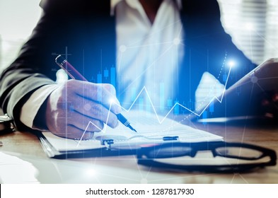 investor or accountant analysis on financial reports with mobile tablet with graphic candle stick graph chart of stock market investment trading for Forex trading, technology, business working concept