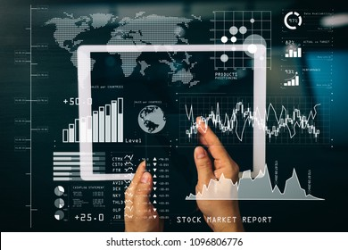 Investor analyzing stock market report and financial dashboard with business intelligence (BI), with key performance indicators (KPI).cyber security internet and networking concept.Businessman works.
