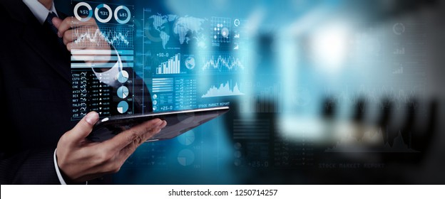 Investor analyzing stock market report and financial dashboard with business intelligence (BI), with key performance indicators (KPI).businessman hand working with finances program on wide screen.