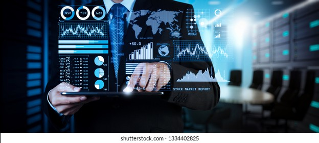 Investor analyzing stock market report and financial dashboard with business intelligence (BI), with key performance indicators (KPI).businessman hand working with finances program on wide scree