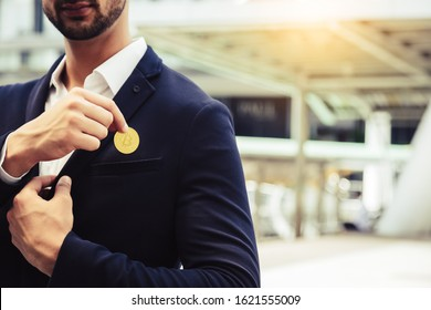 Investor beard guy showing bitcoin in a city. White collar worker put bitcoin to suit pocket. Young business man is bitcoin mining, can earn a lot of money. Future money and life with bitcoin concept