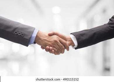 investor business man handshake together on blur room, ceo shake hand together for successful concept.