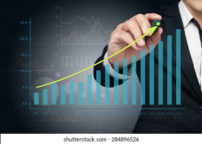 Investor drawing growth chart of profits.