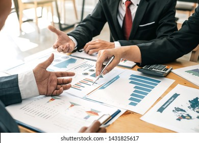 Investor group, business meeting and financial graph data analysis during the meeting.