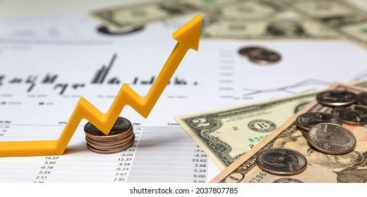 Investor income growth. Up arrow on the chart. Investment report, financial quarterly report, money printed quarterly report and charts on a white background.
