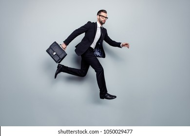 Investor lawyer executive speed urgency delay professional manager student aim exam meeting airport concept. Worried nervous focused depressed with tie handbag in air motion isolated gray background