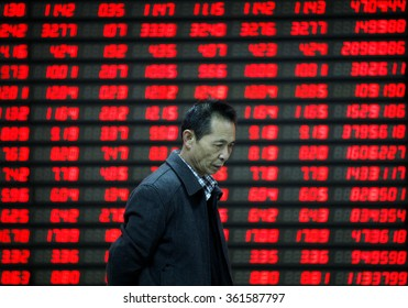 An investor watches electric board in a stock market in Huaibei, Anhui province, east China on 9th November 2015.
