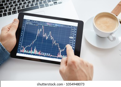 Investor watching the change of stock market on tablet.
