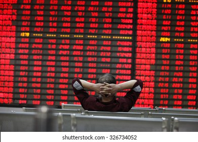 An investor watchs electric board in a stock market in Huaibei, Anhui province, east China on 12th October 2015.