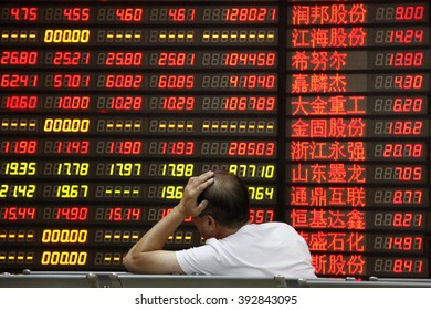 An investor watchs electric board in a stock market in Huaibei, Anhui province, east China on September 7 2015.