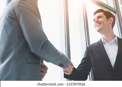 Investors reassure businessman or foreign partners in real estate investment new project.Business people shaking hands. Lawyers join hands with clients to agree on the job with confidence and trust.