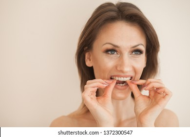 Invisible braces aligner, woman smiling