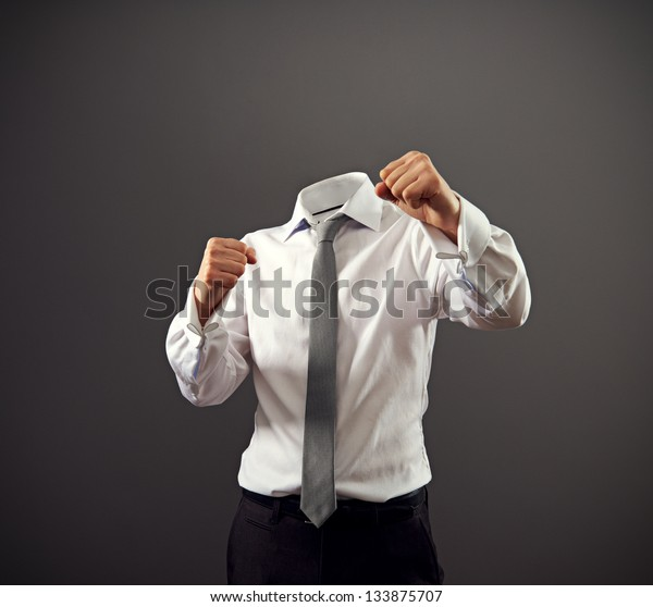 invisible businessman stood in a fighting stance. concept photo