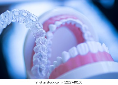Invisible dental teeth aligners brackets used to align each tooth in cosmetic dentistry for patients.