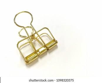 invisible golden binder clip.
