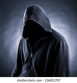 Invisible man in the hood.  Black  background.