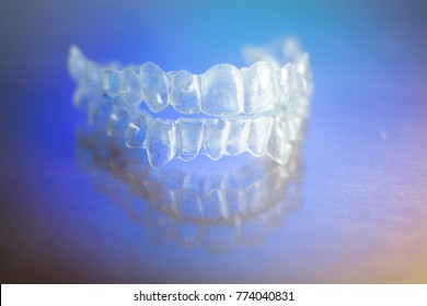 Invisible teeth dental tooth retainer aligner to straighten each tooth in orthodontics treatment for patients.