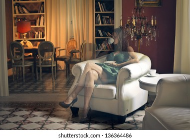 invisible woman drinks a cup of tea sitting on a chair in a beautiful living room