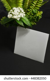 invitation card in envelop with flower