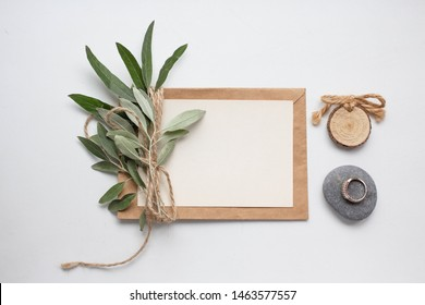 invitation card with leaves, stones and wood