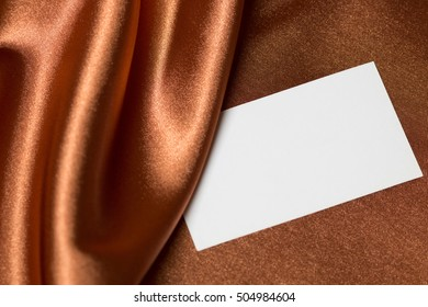 Invitation card on gold silk satin background, space for your message