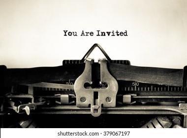 Invitation message typed on vintage typewriter