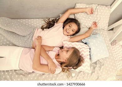 Invite friend for sleepover. Best friends forever. Consider theme slumber party. Slumber party timeless childhood tradition. Girls relaxing on bed. Slumber party concept. Girls just want to have fun.