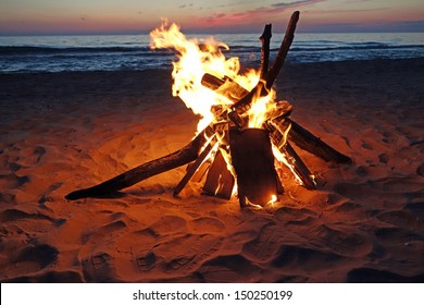 Inviting campfire on the beach during the summer