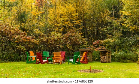 Inviting circle of muskoka chairs around a firepit in the early fall, Thanksgiving, concept, copy space