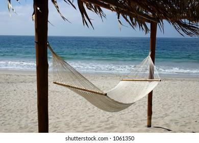 Inviting hammock on the beach