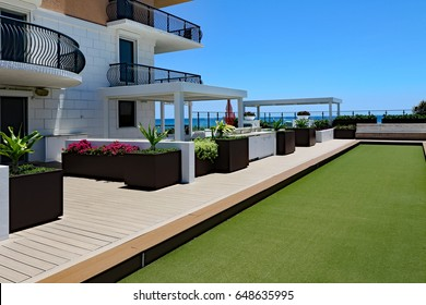 Inviting rooftop bocce ball court and terrace at an oceanfront condo.