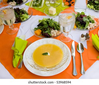 An inviting table is set beautifully and colorfully with nice dishes and a healthy meal.