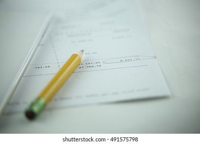 Invoice with pencil and phone, commercial image