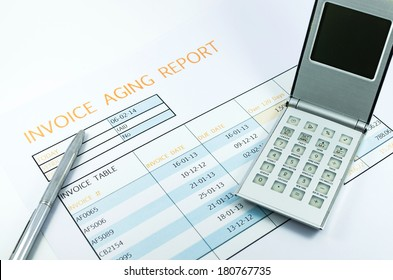 invoice report with calculator and pen for business