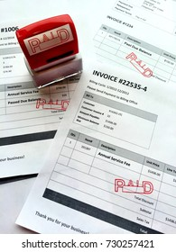 Invoices marked as paid with a rubber stamp