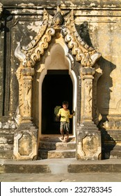 Inwa (Ava), Myanmar, 17 January 2010: Boy walking out the door of Maha Aungmye Bonzan Monastery at Inwa near Mandaley, Myanmar