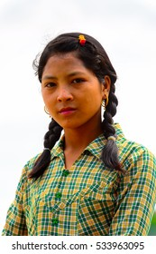 INWA, MYANMAR - AUG 25, 2016: Unidentified Burmese girl with black pictails. 68 per cent of  Myanma people belong to Bamar ethnic group